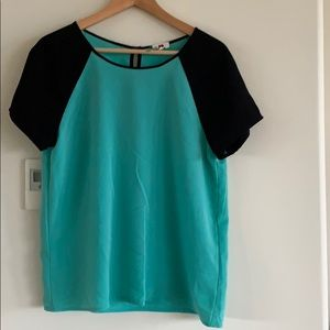 Green and black one clothing blouse, gently worn.